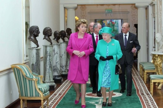 President McAleese and Queen Elizabeth II walking on a Donegal carpet.